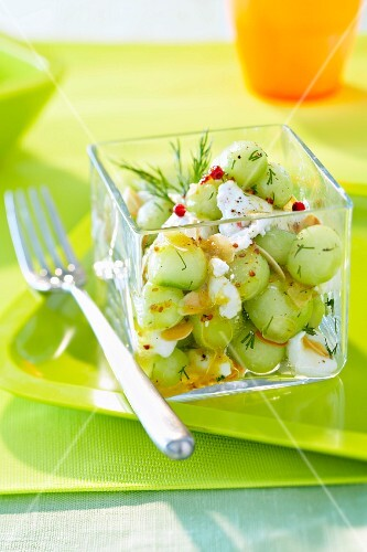Small cucumber balls, fresh goat's cheese and dill salad