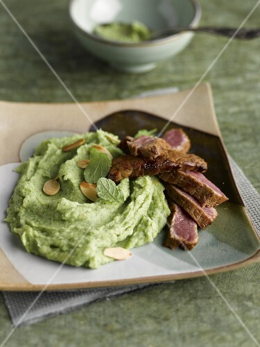 Tataki beef fillet and broccoli puree with thinly sliced almonds