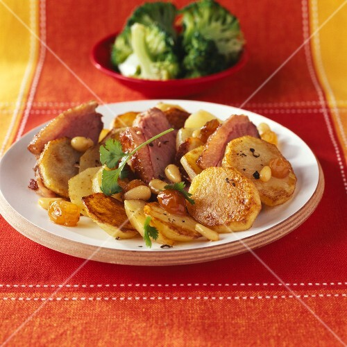 Sauteed potatoes with duck Magret ,raisins and pine nuts