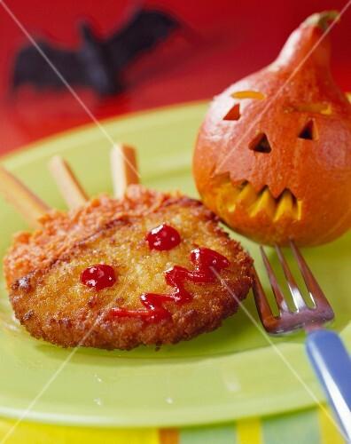 Halloween-style breaded turkey escalope