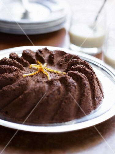 Rich chocolate cake with crystallized orange zests
