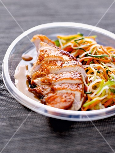 Chicken breast with crisp skin and spaghetti-shaped vegetables