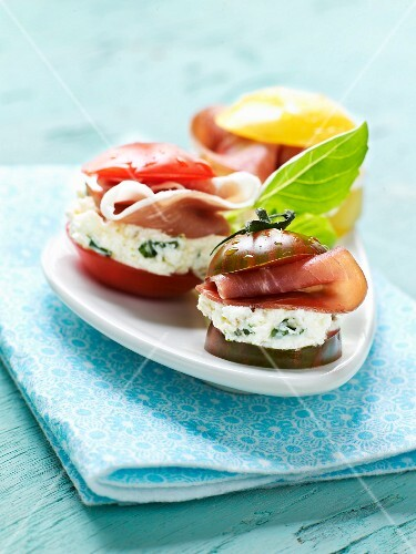Tomato trio with fresh goat's cheese and raw ham