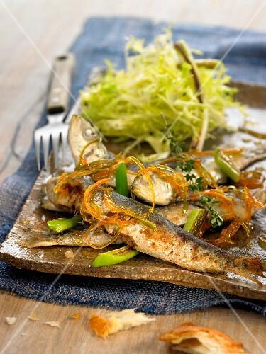 Sardines with citrus fruit zests