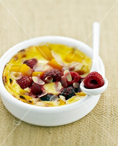 Sabayon with fruit and thinly sliced almonds