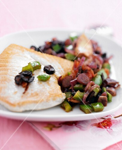 Tuna steak with tomatoes and olives