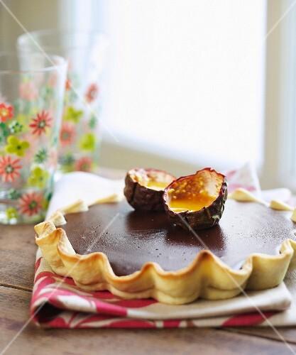 Chocolate tart with passion fruit puree