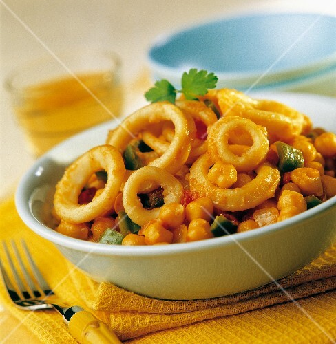 Fried calamary rings with chickpeas in tomato sauce