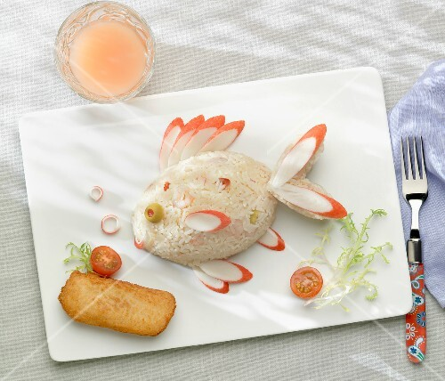 Rice and surimi crab in the shape of a fish