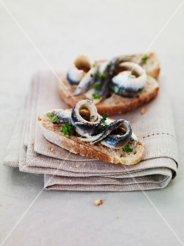 Anchovies with herbs on sliced bread