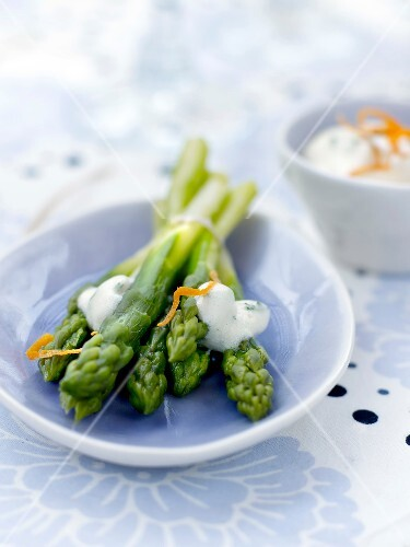 Green asparagus with lght orange emulsion