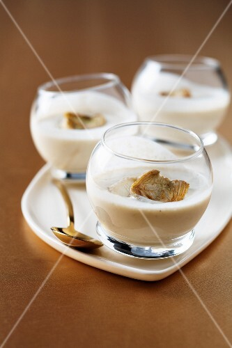Cream of artichoke soup and flaked dried goat's cheese