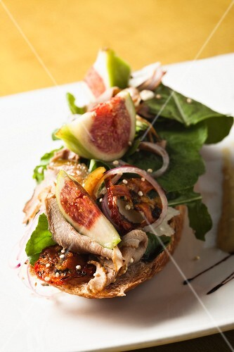 Sliced turkey breast,fig and sun-dried tomato open-sandwich