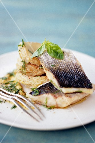 Bass fillet with artichoke bases and basil