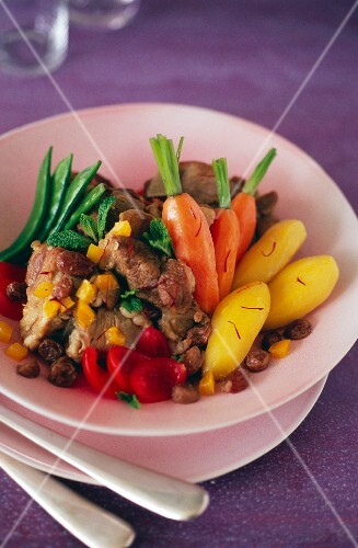 Lamb, saffron, vegetable and raisin Tajine