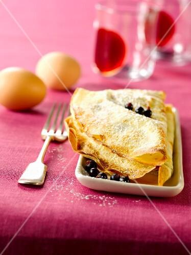Pancake soufflé with blackcurrants