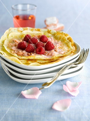 Pancakes with raspberries and rose petals