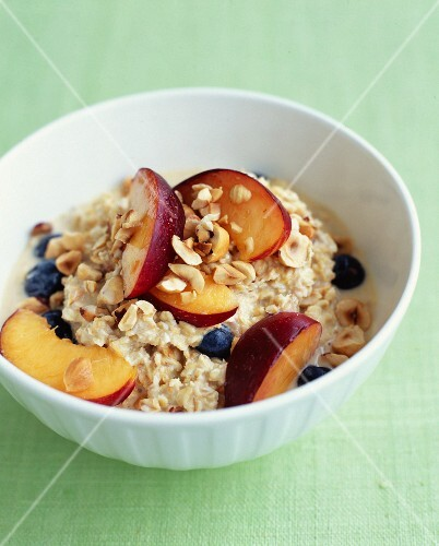 Porridge with nectarines,blueberries and hazelnuts