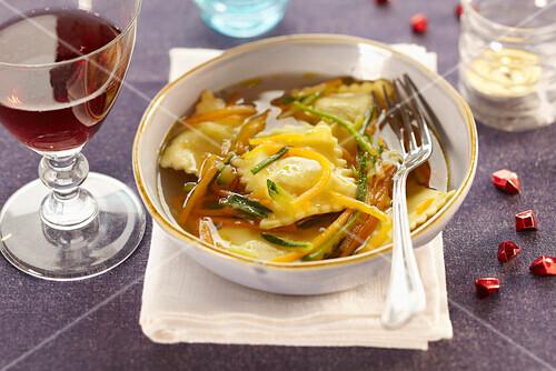 Ravioli and vegetable soup