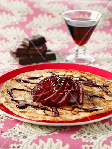 Pancake with pear stewed in red wine and chocolate sauce