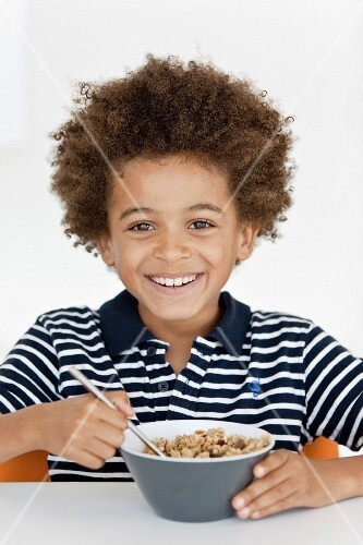 Boy eating a bowl of cereals