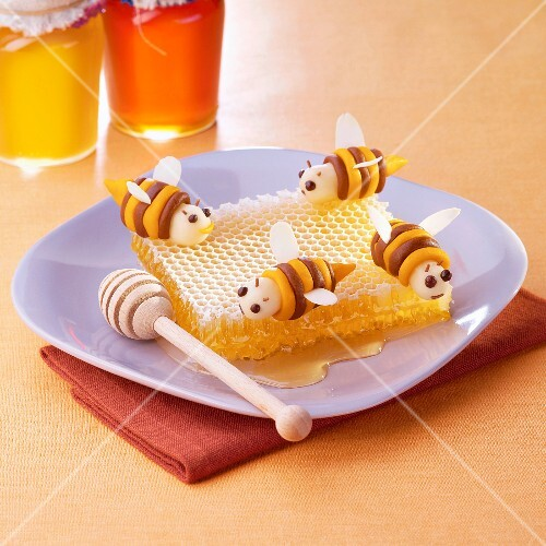 Almond paste bees on a honeycomb