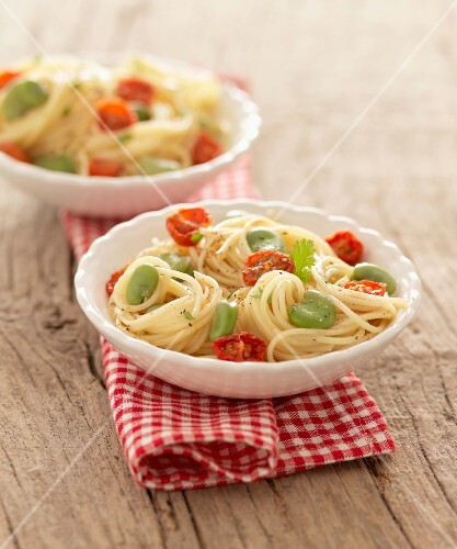 Spaghetti with fava beans and sun-dried cherry tomatoes