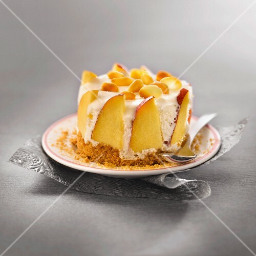Ricotta mousse,peach and thinly sliced almond dessert