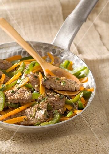 Beef,carrot and green pepper stir-fry
