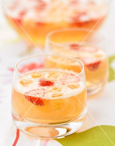 Champagne, strawberry and peach liqueur cocktail