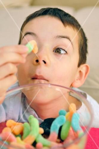 Yonug boy playing with candies
