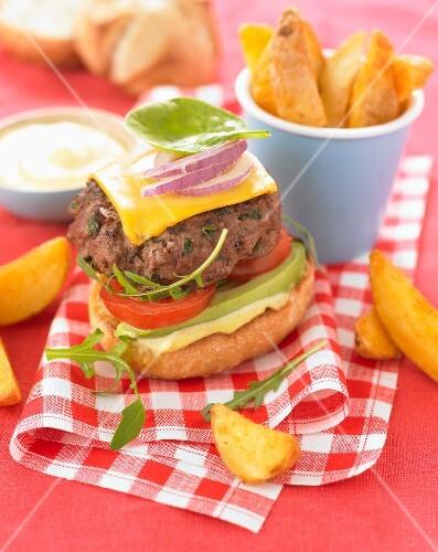 Hamburger with avocado and cheese,potatoes