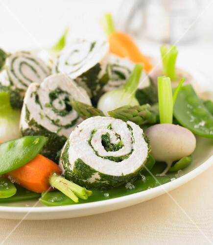 Rolled chicken breasts with herbs,spring vegetables