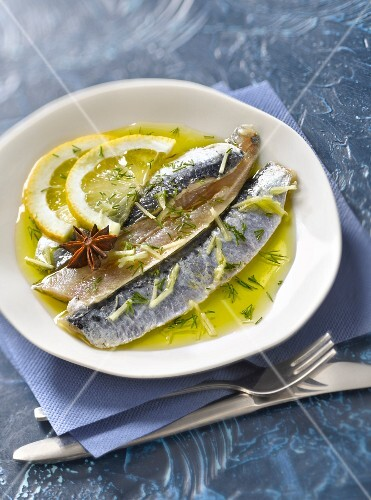 Raw sardine fillets marinated in olive oil,lemon,ginger and star anise