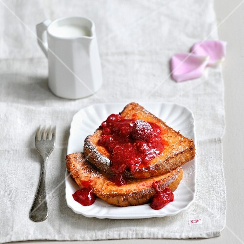 Pink biscuit french toast with stewed summer fruit