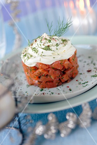 Gravlax-style marinated salmon topped with whipped cream and dill