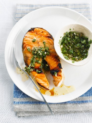 Grilled salmon steak with green salsa