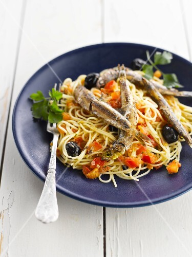 Capellini with anchovies,tomatoes and olives