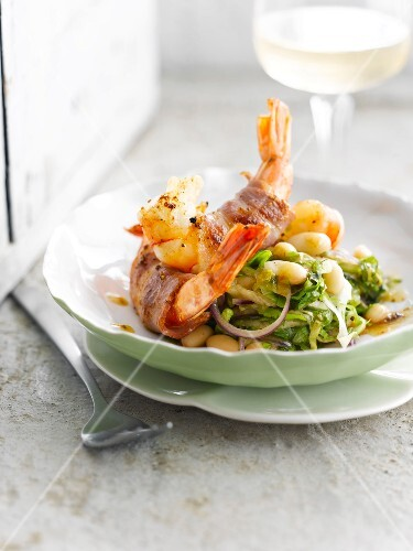 White beans with chicory and shrimps wrapped in crisp bacon