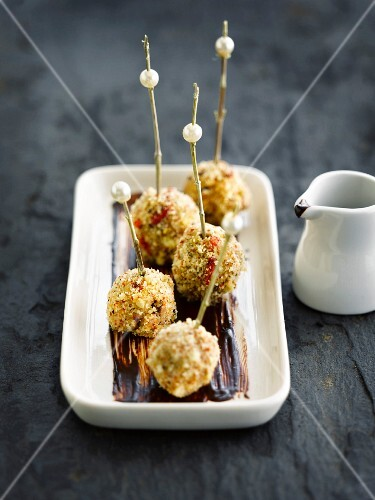Foie gras balls coated in crushed almonds with chocolate