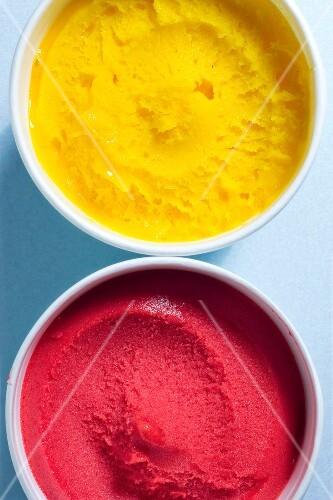 Punnet of raspberry and mango ice cream