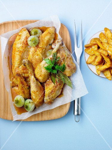 Pieces of roasted free-range chicken with fried potatoes