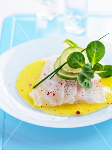 Cod carpaccio with lime juice and pink peppercorns