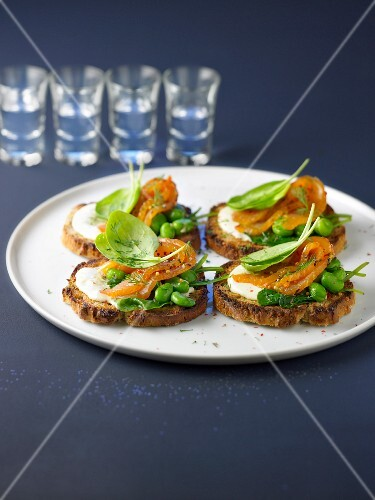 Marinated salmon,horseradish,broad bean and spinach on toasts