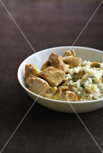Sauteed veal with mushrooms and risotto