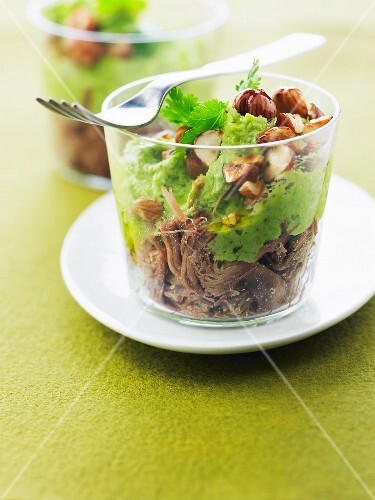 Oxtail with broad bean puree and hazelnuts