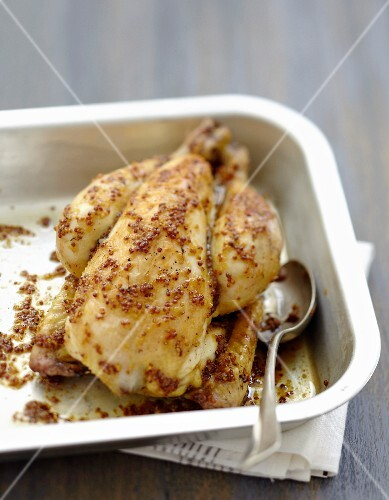 Cockerel coated in maple syrup and mustard seeds