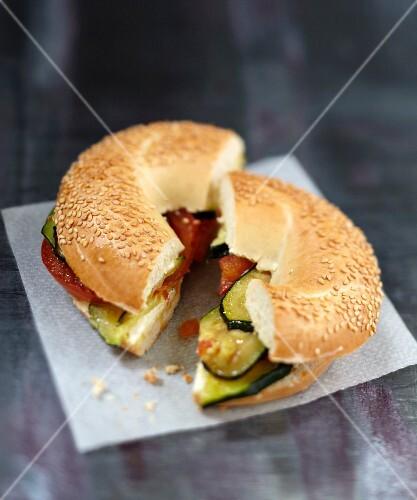 Vegetable and Vache qui rit bagel sandwich