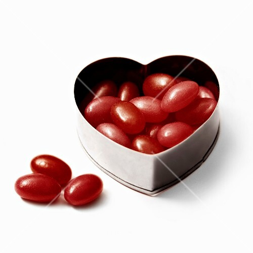 Heart-shaped tin box with summer fruit sweets