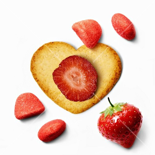 Heart-shaped biscuit ,fresh strawberries and strawberry Tagada